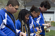 Middletown, New York - Members of the Middletown High School Marching Middies band line up before the start of the 60th annual Middletown Little League parade on April 14, 2013.