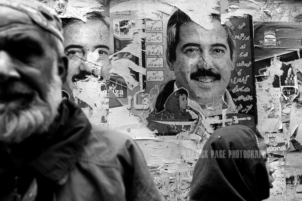 Posters of Murtaza Bhutto; father of Fatima Bhutto, the estranged niece of assassinated former prime minister, Benazir Bhutto, and granddaughter Zulfikar Ali Bhutto, line the walls of a marketplace in an impoverished neighbourhood, February 4, 2008 in Karachi, Pakistan. Fatima is a writer and a poet whose father, Murtaza, was assassinated by police during the premiership of Benazir Bhutto in 1996. It has been widely speculated that she will eventually enter politics; a rumour she strongly denies. (Photo by Warrick Page)