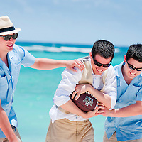 Dan and his brothers play a game of pickup football at the beach in Xpuha, Mexico after their wedding on the Mayan Riviera.