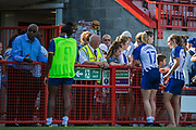 Ini Umotong (Brighton), Megan Connolly (Brighton) & Aileen Whelan (Brighton) talking with Brighton & Hove Albion FC supporters following the FA Women's Super League match between Brighton and Hove Albion Women and Chelsea at The People's Pension Stadium, Crawley, England on 15 September 2019.