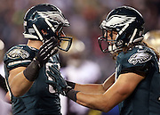Philadelphia Eagles tight end Zach Ertz (86) celebrates with Philadelphia Eagles wide receiver Riley Cooper (14) after Ertz catches a fourth quarter touchdown pass that gives the Eagles a 24-23 lead during the NFL NFC Wild Card football game against the New Orleans Saints on Saturday, Jan. 4, 2014 in Philadelphia. The Saints won the game 26-24. ©Paul Anthony Spinelli