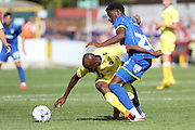 Tom Elliott and Nadjim Adbou in action during the Friendly match between AFC Wimbledon and Millwall at the Cherry Red Records Stadium, Kingston, England on 18 July 2015. Photo by Stuart Butcher.
