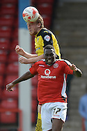 Tom Eastman of Colchester United looks to win a header in the air against Mathieu Manset of Walsall during the Sky Bet League 1 match between Walsall and Colchester United at the Banks's Stadium, Walsall<br /> Picture by Richard Blaxall/Focus Images Ltd +44 7853 364624<br /> 06/09/2014