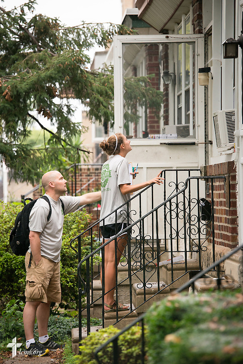 The Rev. Mark Kiessling, associate director of LCMS Youth Ministry, joins Kalli Parauka of the 2014 Youth Corps pilot project as they knock on doors during a Gospel Seeds training session near Shepherd of the City Lutheran Church on Tuesday, August 12, 2014, in Philadelphia, Pa. LCMS Communications/Erik M. Lunsford
