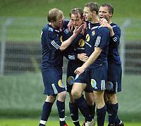 Fotball, 13. mai 2003, NM fotball herrer, Strømsgodset-Bærum, Kim Larsen, Strømsgodset, jubler etter scoring sammen med Lasse Olsen, Hans Erik Ødegaard og Lars Granaas