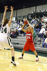 29 January 2011: Mackenzie Floyd holds Kristi Schmidt outside the 3 point line during an NCAA Womens basketball game between the Carthage Reds and the Illinois Wesleyan Titans at Shirk Center in Bloomington Illinois.