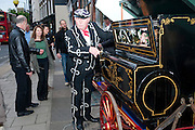 Pearly King performing with a barrel organ, The Pimlico Road Summer party. London SW1. 9 June 2009