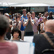 """June 21, 2014 - New York, NY : <br /> The city was flooded with music on Saturday as Make Music New York brought more than 1,300 free concerts to the city's streets and parks. The annual festival's program included the performance """"'In (Key)' - New Compositions in Celebration of Terry Riley's 'In C' @ 50 Years"""" on Cornelia Street, in front of the Cornelia Street Cafe in Greenwich Village, on Saturday afternoon. Pictured here, the audience applauds at the conclusion of one of the pieces. <br /> CREDIT: Karsten Moran for The New York Times"""