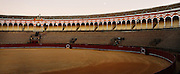 "Panoramic view of the arena, Plaza de Toros de la Real Maestranza de Caballeria de Sevilla, Seville, Spain, pictured on January 2, 2007, in the afternoon. The Plaza de Toros de la Real Maestranza, 1762-1881, is the oldest bullring in Spain. Its Baroque facade, was built by several architects. The arena seats 14,000 and is known for its wonderful acoustics. It is the setting for Bizet's opera ""Carmen"". Picture by Manuel Cohen."