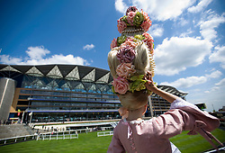 © licensed to London News Pictures. 14/06/2011. Ascot, UK.  Anneka Tanaka-Svenska arriving on day one at Royal Ascot races today (14/03/2011). The 5 day showcase event,  one of the highlights of the racing calendar is in it's 300th year. Horse racing has been held at the famous Berkshire course since 1711 and tradition is a hallmark of the meeting. Top hats and tails remain compulsory in parts of the course. Photo credit should read: Ben Cawthra/LNP