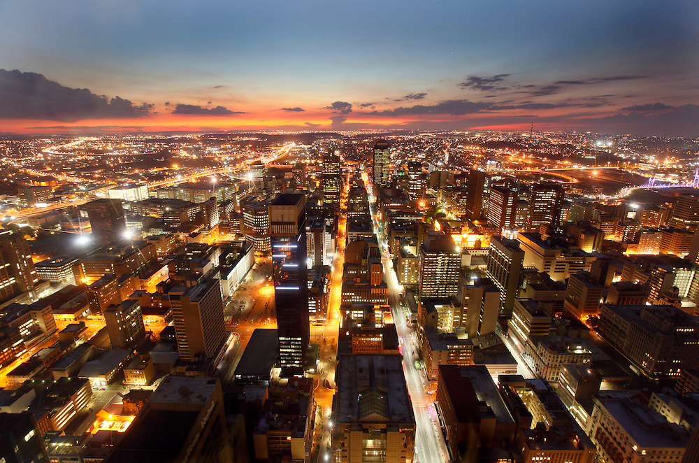 The lights and action of Johannesburg CBD at night seen from the Carlton tower. Johannesburg, South Africa.