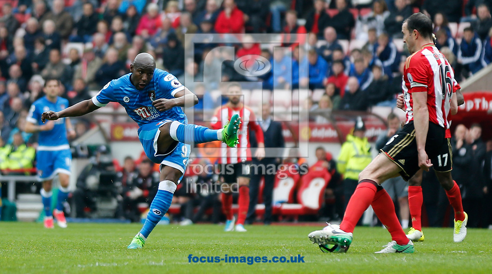 John O'Shea (r) of Sunderland blocks a shot from Benik Afobe of Bournemouth during the Premier League match at the Stadium Of Light, Sunderland<br /> Picture by Simon Moore/Focus Images Ltd 07807 671782<br /> 29/04/2017