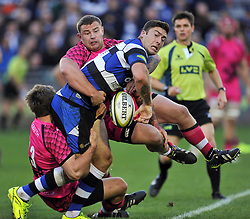 Matt Banahan of Bath Rugby looks to offload the ball after being tackled by Nic Reynolds and Koree Britton of London Welsh - Photo mandatory by-line: Patrick Khachfe/JMP - Mobile: 07966 386802 01/11/2014 - SPORT - RUGBY UNION - Bath - The Recreation Ground - Bath Rugby v London Welsh - LV= Cup