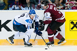 Petteri Nokelainen of Finland vs Rekis Arvids of Latvia during ice-hockey match between Latvia and Finland of Group D of IIHF 2011 World Championship Slovakia, on May 2, 2011 in Orange Arena, Bratislava, Slovakia. (Photo by Matic Klansek Velej / Sportida)