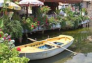 An old wooden rowboat next to<br /> waterside cafes in Kalekoy, Turkey<br /> c. Ellen Rooney