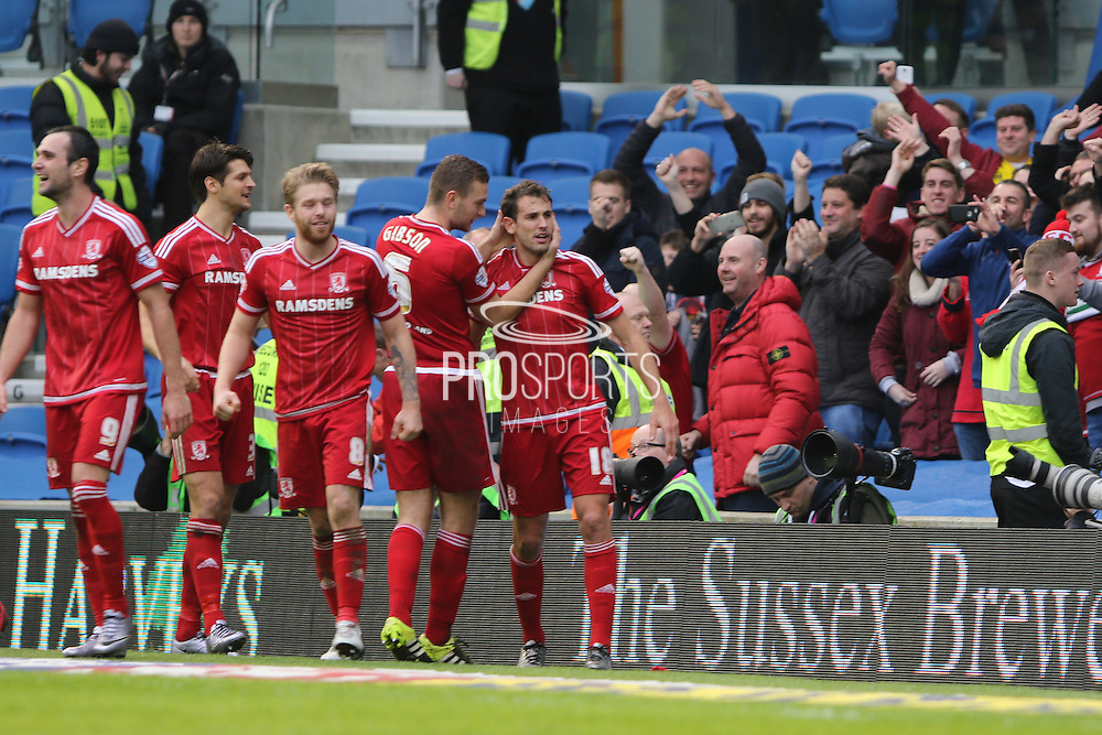 Middlesbrough FC striker Christian Stuani is congratulated by Middlesbrough FC defender Ben Gibson after scoring Middlesbroughs third goal during the Sky Bet Championship match between Brighton and Hove Albion and Middlesbrough at the American Express Community Stadium, Brighton and Hove, England on 19 December 2015. Photo by Geoff Penn.