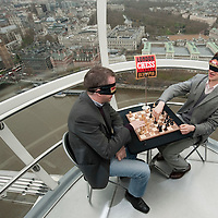 LONDON, ENGLAND - DECEMBER 07:  English Chess Grand Masters Luke McShane and Nigel Short play a game on the London Eye to promote 'The London Chess Classic Tournament' on December 7, 2009 in London, England.  The Classic is the first world class chess tournament to be staged in the UK for 25 years and will be held in London from December 8 to December 15....***Agreed Fee's Apply To All Image Use***.Marco Secchi /Xianpix. tel +44 (0) 771 7298571. e-mail ms@msecchi.com .www.marcosecchi.com
