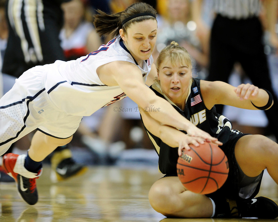 UConn's Kelly Faris dives to poke the ball away from Purdue's Brittany Rayburn in the second round of NCAA women's tournament action Tuesday, March 22, 2011 at Gampel Pavilion in Storrs. UConn battled to a 28-13 lead at the half. (Sean D. Elliot/The Day)