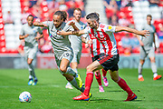 Marcus Harness (#19) of Portsmouth FC takes on Conor McLaughlin (#2) of Sunderland AFC during the EFL Sky Bet League 1 match between Sunderland and Portsmouth at the Stadium Of Light, Sunderland, England on 17 August 2019.
