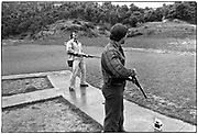 April 1976  •  Santa Monica mtns, CA  • trap shooting with a friend in Los Angeles mtns  with friend, Roger Callard (at right)  •  magazine assignment (Bunte)  •   Tri-X  •