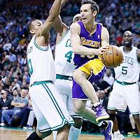 07 February 2013: Los Angeles Lakers point guard Steve Nash (10) drives past Boston Celtics point guard Avery Bradley (0) and Boston Celtics power forward Chris Wilcox (44) during the Boston Celtics 116-95 victory over the Los Angeles Lakers at the TD Garden, Boston, Massachusetts, USA.