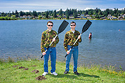 Mountlake Terrace, Washington - July 13, 2015: Prince Aaron and King Adam I of &Uuml;berstadt stand for a portrait in their camouflage BDU's on the shore of Lake Ballinger before voyaging to Edmount Island, which is &quot;considered the spiritual homeland of the nation.&quot; After rowing as close to the peat island as they can, the Oberstadt brothers will enact &quot;their first official Mark of &Uuml;berstadt's sovereignty&quot; tossing a small paper laminated flag onto the island. <br /> <br /> After the great BBQ fire of 2009, setting foot on the island has been deemed illegal by the local authorities. The fire is considered to be the event that solidified the early &Uuml;berstadtis. <br /> <br /> <br /> <br /> The Kingdom of &Uuml;berstadt is led by nineteen-year-old King Adam I, (Adam Oberstadt). The Barony of Rosewood -- the micronation's capitol and the Oberstadt family home -- is nestled in the Seattle suburb of Mountlake Terrace, Wash. <br /> &Uuml;berstadt also claims territory of nearby Edmount Island on Lake Ballinger -- called The Barony of Ballinger and &quot;considered the spiritual homeland of the nation.&quot; Both baronies reside within the Duchy of Edmount which &quot;is situated entirely within the boundaries of the city of Mountlake Terrace, Washington,&quot; according to the &Uuml;berstadt website.<br /> &Uuml;berstadt  was founded by King Adam I and his high school friends March 6, 2010, and was governed by judges as a kritarchy. Before taking the crown, Adam was &Uuml;berstadt's chief judge. After graduation, many of the &Uuml;berstadti moved away to college and &Uuml;berstadt's populace shrank. Activities would shift from the high school to Rosewood, and the governing style morphed to a unitary constitutional monarchy. According to the micronation's website &Uuml;berstadt is a sovereign state &quot;guided by the principles of direct democracy, socialist economics, and environmentalism.&quot; <br /> <br /> CREDIT: Matt Roth