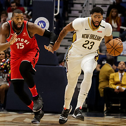 Oct 11, 2018; New Orleans, LA, USA; New Orleans Pelicans forward Anthony Davis (23) drives past Toronto Raptors center Greg Monroe (15) during the first half at the Smoothie King Center. Mandatory Credit: Derick E. Hingle-USA TODAY Sports