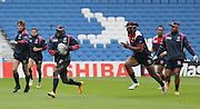 Players passing the ball along the line during the USA Captain's Run in preparation for the Rugby World Cup at the American Express Community Stadium, Brighton and Hove, England on 18 September 2015.