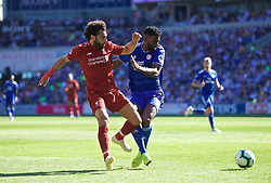 CARDIFF, WALES - Saturday, April 20, 2019: Liverpool's Mohamed Salah (L) and Cardiff City's Bruno Ecuele Manga (R) during the FA Premier League match between Cardiff City FC and Liverpool FC at the Cardiff City Stadium. (Pic by David Rawcliffe/Propaganda)