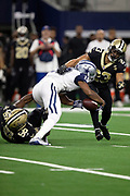 Dallas Cowboys wide receiver Amari Cooper (19) gets gang tackled by New Orleans Saints outside linebacker Demario Davis (56) and New Orleans Saints cornerback Marshon Lattimore (23) causing a second quarter fumble recovered by Lattimore at the Cowboys 39 yard line during the NFL week 13 regular season football game against the New Orleans Saints on Thursday, Nov. 29, 2018 in Arlington, Tex. The Cowboys won the game 13-10. (©Paul Anthony Spinelli)