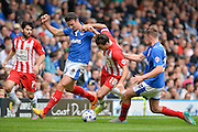 Matt Clarke tackles Terry Gornell during the Sky Bet League 2 match between Portsmouth and Accrington Stanley at Fratton Park, Portsmouth, England on 5 September 2015. Photo by Adam Rivers.