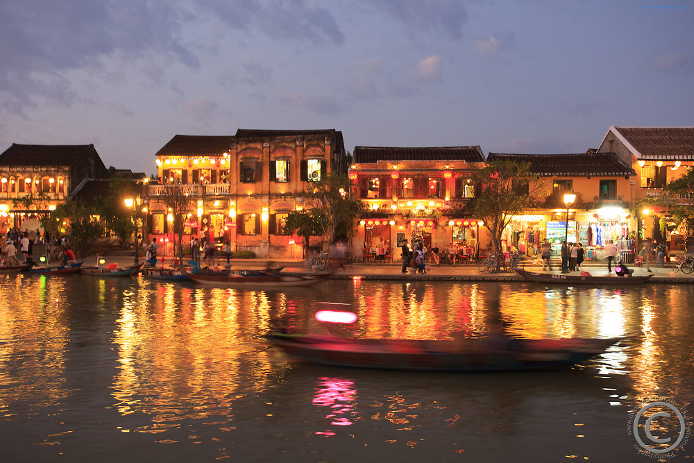 Cruising along the Thu Bon river is a popular activity for tourists in Hoi An, Vietnam