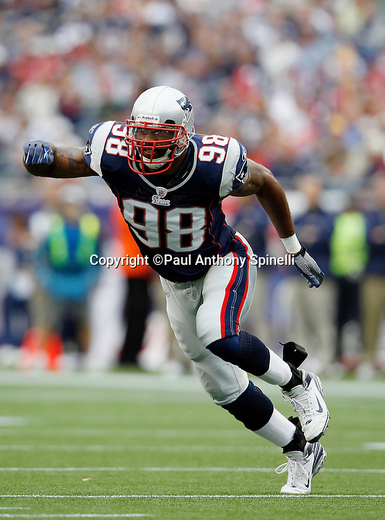 New England Patriots linebacker Shawn Crable (98) chases the action during the NFL regular season week 3 football game against the Buffalo Bills on September 26, 2010 in Foxborough, Massachusetts. The Patriots won the game 38-30. (©Paul Anthony Spinelli)
