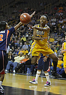 February 24 2011: Iowa Hawkeyes guard Kachine Alexander (21) passes the ball during the first half of an NCAA women's college basketball game at Carver-Hawkeye Arena in Iowa City, Iowa on February 24, 2011. Iowa defeated Illinois 83-64.
