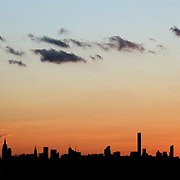 2016 U.S. Open - Day 6 The Manhattan New York City skyline at sunset showing the Empire State Building and the Chrysler building shot from the Arthur Ashe Tennis Stadium at the USTA Billie Jean King National Tennis Center on September 3, 2016 in Flushing, Queens, New York City. (Photo by Tim Clayton/Corbis via Getty Images)