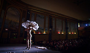 Scarlet Mary Rose puts on a Burlesque performance during an evening Vaudeville Show at the 100-year-old Patricia Theatre in Powell River, BC. (2013)