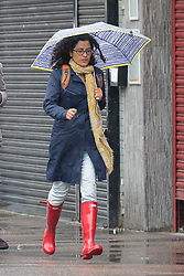 © Licensed to London News Pictures. 23/09/2018. London, UK.  A woman walking in Walthamstow, north-east London during rain and wet weather this morning.  Photo credit: Vickie Flores/LNP