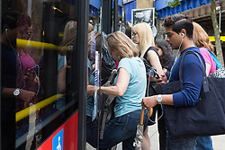© Licensed to London News Pictures. 06/08/2015. London, UK. People board busses at Waterloo station in London. A tube strike today has closed the TfL London Underground network as members of four unions take industrial action for the second time in a month because of a deadlocked dispute over plans to launch a new all-night tube train service next month. Extra busses have been laid on to help commuters get to work. Photo credit : Vickie Flores/LNP