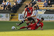 York City midfielder James Berrett tackles Notts County midfielder Alan Smith during the Sky Bet League 2 match between Notts County and York City at Meadow Lane, Nottingham, England on 26 September 2015. Photo by Simon Davies.