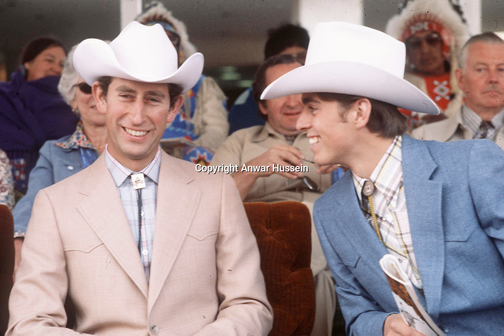 Charles, Prince of Wales and Prince Andrew, later Duke of York,  wear white stetsons at the Calgary Stampede in Canada in 1977..