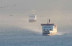 © Licensed to London News Pictures. 01/01/2019. Dover, UK. Dover Calais ferry traffic moves at first light as Border Force monitors shipping in the middle of the English Channel.  As the number of migrants willing to risk crossing the English Channel from France continues to grow, the UK government have increased the number of Border Force Cutters available to three.  Photo credit: Peter Macdiarmid/LNP