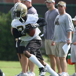 2008 May 21: Reggie Bush of the New Orleans Saints runs with the ball during team organized activities at the team's training facility in Metairie, LA. .