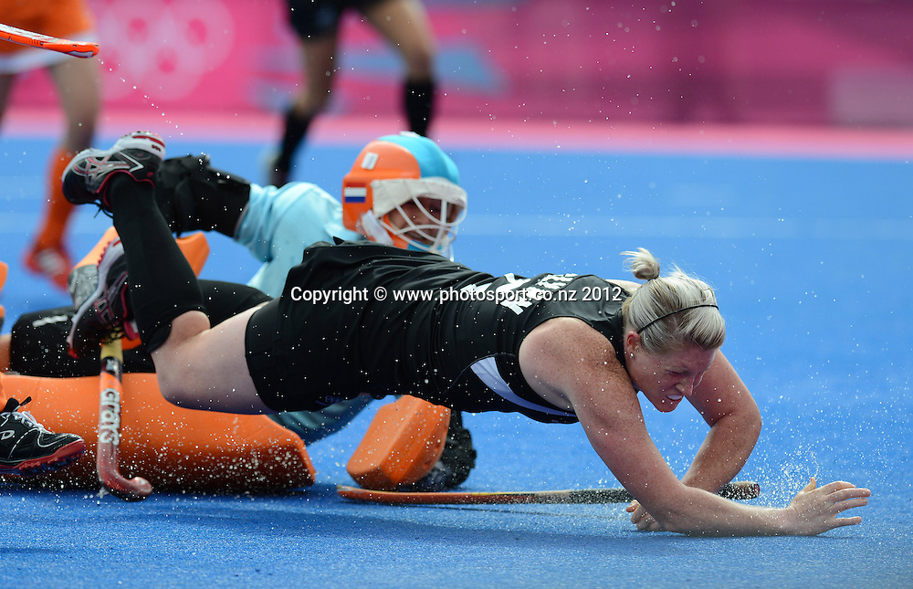 New Zealand's Katie Glynn colliedes with the Netherlands goal keeper Joyce Sombroek during the Womens Hockey Semi Final match, New Zealand v Netherlands at Riverbank Arena, Olympic Games, London. United Kingdom. Wednesday 8 August 2012. Photo: Andrew Cornaga / Photosport.co.nz