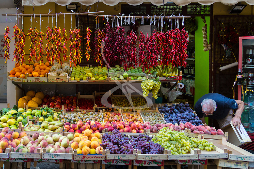 Sorrento, Italy, September 15 2017. A traditional greengrocer lays out his wares in Sorrento, Italy. © Paul Davey