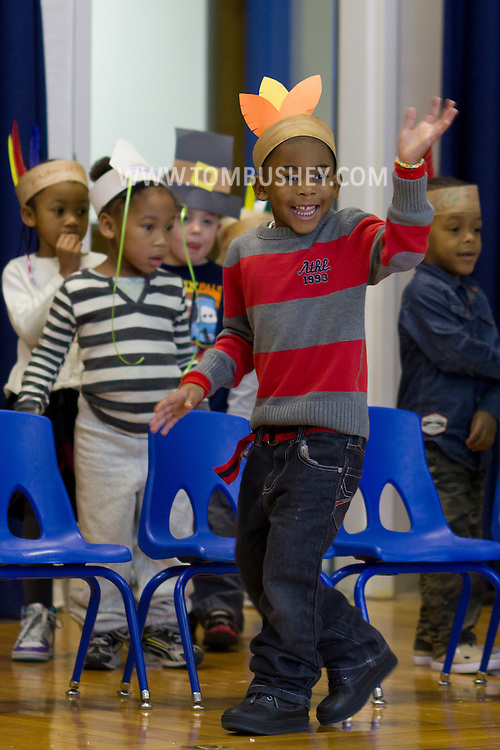 "Middletown, New York - A  student waves at the start of the ""YMCA Thanksgiving Day Spectacular"" on the stage at the Center for Youth Programs on Nov. 27, 2013."