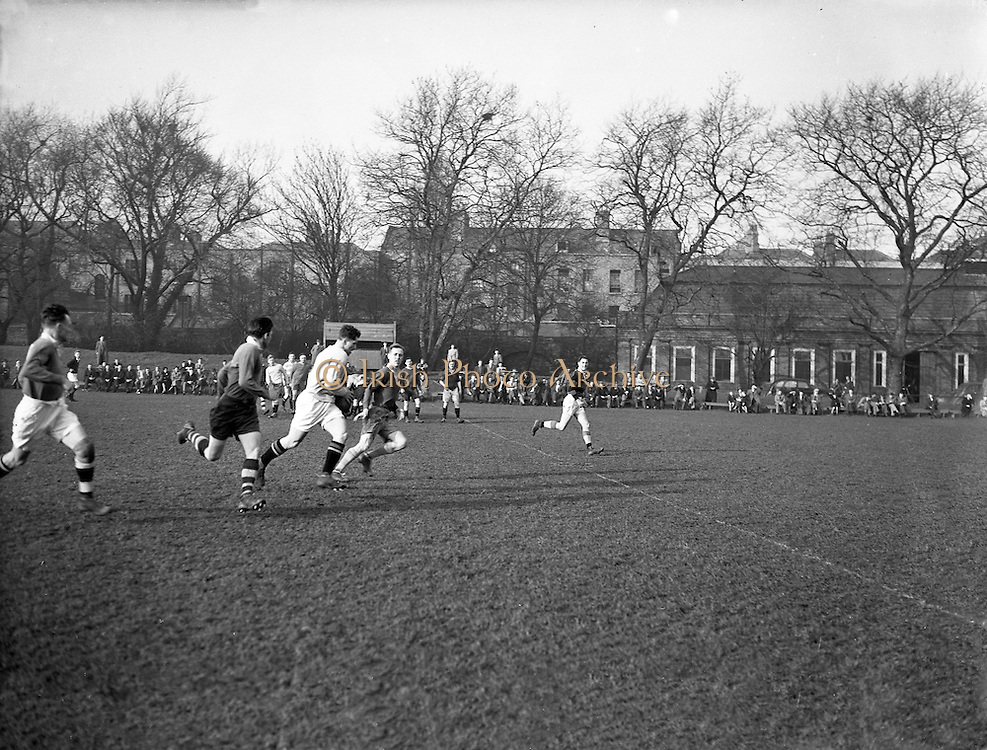 Irish Rugby Football Union, Ireland v Wales, Five Nations, Irish Rugby team practice at College Park,  Dublin, Ireland, Friday 12th March, 1954,.12.3.1954, 3.12.1954,..Referee- A W C Austin, Scottish Rugby Union, ..Score- Ireland 9 - 12 Wales,..Irish Team, ..P Berkery, Wearing number 15 Irish jersey, Full back, Landsdowne Rugby Football Club, Dublin, Ireland,..M Mortell, Wearing number 14 Irish jersey, Right wing, Bective Rangers Rugby Football Club, Dublin, Ireland, ..N J Henderson, Wearing number 13 Irish jersey, Right centre, N.I.F.C, Rugby Football Club, Belfast, Northern Ireland,..R P Godfrey, Wearing number 12 Irish jersey, Left Centre, University College Dublin Rugby Football Club, Dublin, Ireland,..J T Gaston, Wearing number 11 Irish jersey, Left wing, Dublin University Rugby Football Club, Dublin, Ireland, ..S Kelly, Wearing number 10 Irish jersey, Stand Off, Landsdowne Rugby Football Club, Dublin, Ireland, ..J A O'Meara, Wearing number 9 Irish jersey, Scrum half, Dolphin Rugby Football Club, Cork, Ireland, ..J H Smith, Wearing number 1 Irish jersey, Forward,  London Irish Rugby Football Club, Surrey, England, ..R Roe, Wearing number 2 Irish jersey, Forward, Dublin University Rugby Football Club, Dublin, Ireland,..F E Anderson, Wearing number 3 Irish jersey, Forward, Queens University Rugby Football Club, Belfast, Northern Ireland,..J R Brady, Wearing number 4 Irish jersey, Forward, C I Y M S Rugby Football Club, Belfast, Northern Ireland, ..R H Thompson, Wearing number 5 Irish jersey, Forward, Instonians Rugby Football Club, Belfast, Northern Ireland, ..J S McCarthy, Wearing number 6 Irish jersey, Captain of the Irish team, Forward, Dolphin Rugby Football Club, Cork, Ireland, ..R Kavanagh, Wearing number 7 Irish jersey, Forward, Wanderers Rugby Football Club, Dublin, Ireland, ..G Reidy, Wearing number 8 Irish jersey, Forward, Dolphin Rugby Football Club, Cork, Ireland, and, Landsdowne Rugby Football Club, Dublin, Ireland,  ..Welsh Team, ..V Evans, Wearing