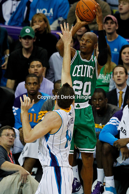 December 28, 2011; New Orleans, LA, USA; Boston Celtics shooting guard Ray Allen (20) shoots over New Orleans Hornets power forward Jason Smith (14) during the third quarter of a game at the New Orleans Arena. The Hornets defeated the Celtics 97-78.  Mandatory Credit: Derick E. Hingle-US PRESSWIRE