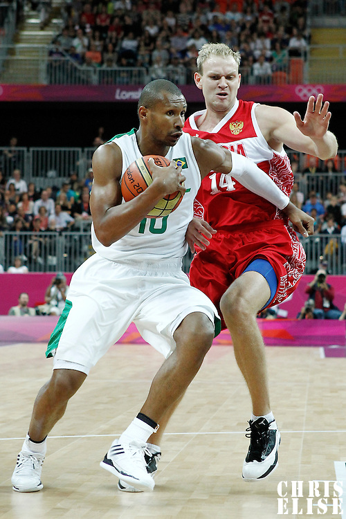 02 August 2012: Brazil Leandrinho Barbosa drives past Russia Anton Ponkrashov during 75-74 Team Russia victory over Team Brazil, during the men's basketball preliminary, at the Basketball Arena, in London, Great Britain.