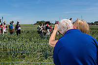 20150614 Ligny Belgium. The Battle of Ligny (16 June 1815) was the last victory of the military career of Napoleon I.Today it was re-enacted by 1500 people just a few days before the 200th birth day of Napoleon's final loss at Waterloo. A couple of tourists kiss while watching the re-enactors in action