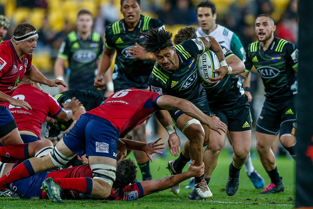 Ardie Savea tackled by Angus Scott-Young during the Super rugby union game (Round 14) played between Hurricanes v Reds, on 18 May 2018, at Westpac Stadium, Wellington, New  Zealand.    Hurricanes won 38-34.
